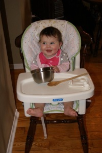 Baby Lila working in the kitchen